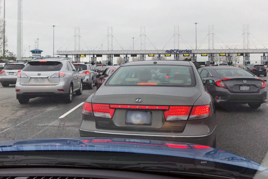 Jammed ferry door forces cars to back off vessel